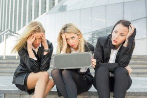 Three depressed corporate business women