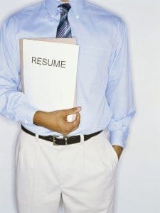 mid section view of a man holding his resume